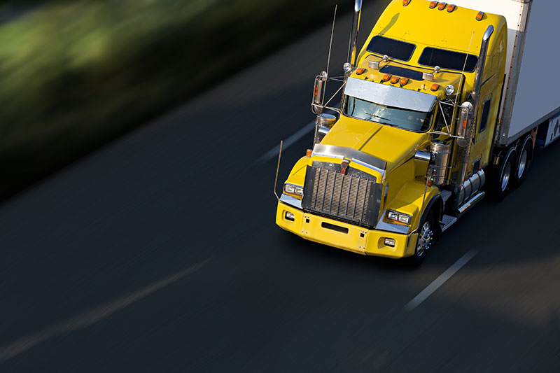 yellow truck on road